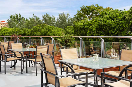 Enjoy a pleasant atmosphere on the terrace, where you can ...